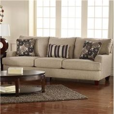 Beige couch with dark brown accents
