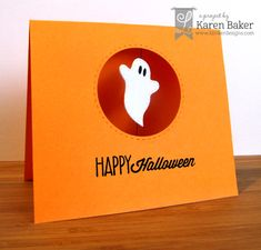 handmade Halloween card from Lil' Inker Designs ... clean and simple ... cute die cut ghost floating on an acetate panel in a circle port hole ... orange card with black embossed sentiment ... luv it!