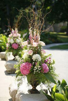 Outdoor wedding arrangements or same flowers could be used for an indoor arrangement. No curly willow on top!