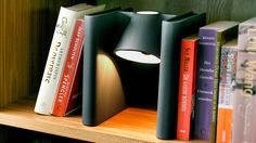 Clever Bookend Lamp Hides Between Hemingway and Shakespeare: cool lighting solution for built-ins, other bookshelves.