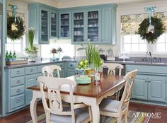 Pretty cupboard color with wreaths on windows