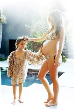 my sweet friend Josie with her daughter Rumi, and the new little one due just one week before mine--via The Glow