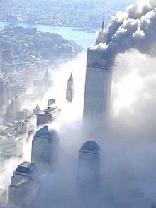 The north tower continues to burn after the collapse of the south tower