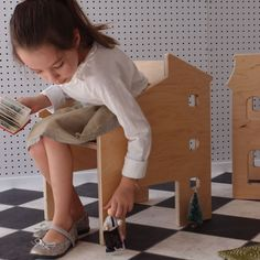 Is it a chair? A dollhouse? It's both! The perfect place for your little ones to sit and play.