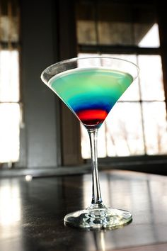 Bomb Pop Martini.  Tastes just like you melted the popsicle into your drink.  Sugared rim would make it even better!