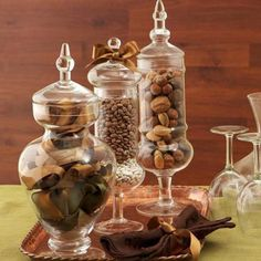 Footed glass containers show off ribbons, beans and nuts in pretty Thanksgiving hues. More decorating ideas: http://www.midwestliving.com/holidays/thanksgiving/easy-ideas-for-thanksgiving-decorating/?page=6,0