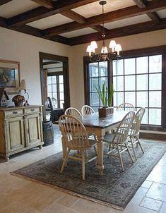 breakfast room, beamed ceiling, rug