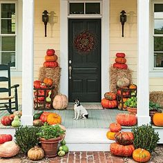 Porch Pumpkin Patch | Decorate the porch with pumpkins, gourds, and hay bales for a look straight out of the pumpkin patch. | SouthernLiving.com