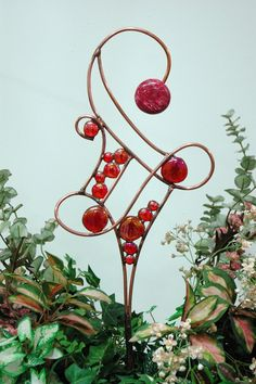 Stained Glass Garden Art Projects | mnartists.org | Jan Geisen | Parallel Red Wave Plant Stake