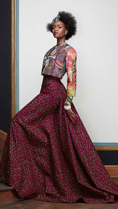 FESTIVE FAVOURITE   Voluptuously grandiose, this long, elegant skirt finished with long sleeves is a joy of Vlisco fabric. The intricate design of the jacket completes this look that is both flamboyant and elegant in the same breath.