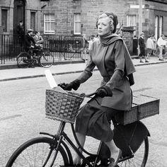 Maggie Smith rides a bike.