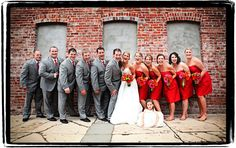 Grey and Red wedding colors. I really love grey for a wedding. It's still striking but not as harsh as black. It pairs better with other colors, as well.