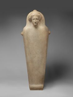 """ancientpeoples:  Marble Anthropoid Sarcophagus Late 5th Century BCE Graeco-Phoenician The lid of the sarcophagus shows an unarticulated, downward tapering body and the head of a woman framed by flowing hair; traces of red paint are still preserved in the hair. At the foot end of the box and on the lid appears the Phoenician letter """"shin."""" According to recent investigations, the anthropoid sarcophagi of marble were quarried on the Greek island of Paros. They were prepared up to a certain ..."""