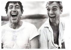 Robert Downey Jnr & Jude Law share a joke.