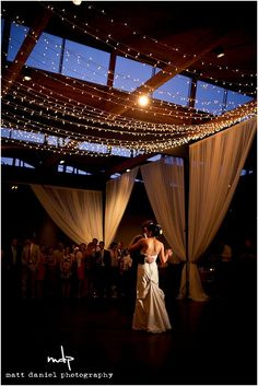 Specialty lighting: string lights over the dance floor