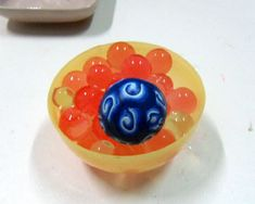 Using Water Absorbing Crystal gel to create hollow beads  http://www.garieinternational.com.sg/clay/shop/gel_crystal.htm