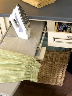 I'm completely amazed by this drawer-mounted pull-out ironing board. Completely. via: http://www.bhg.com/rooms/laundry-room/makeovers/laundry-room-cabinetry-ideas/#page=15
