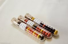 Test tube favours, but filled with skittles in our colours.  Great idea for a lab week giveaway!
