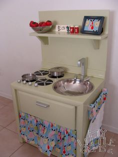 Dishfunctional Designs: Old Furniture Upcycled Into Dollhouses & Play Kitchens - This cute kid's play kitchen was made by My Little Gems Blog.  Check out their DIY.