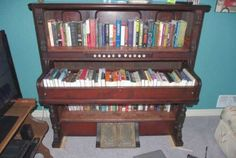 26 Inventive DIY Ideas for how to repurpose old pianos. This is an old pump organ turned into a bookcase! #Music #Piano #HowTo #DIY