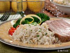 How about a light and easy side dish to accompany tonight's supper? It's the perfect go-along for everything from chicken to ribs.  Read more at http://www.mrfood.com/Potatoes-Rice/Lemon-Garlic-Rice#d7xBiS8MobJAyaRG.99