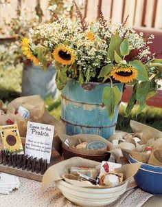 Love the blue vintage pail for sunflowers...