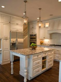 Cream and white kitchen with hints of light pink and grey