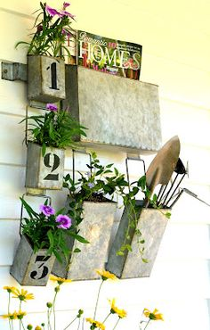 This little galvanized cubby wall hanger is great storage. but I also used it as a fun planter.  So versatile on our farmhouse porch!