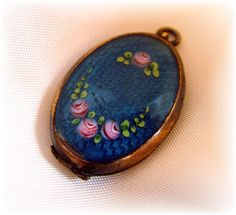 Blue guilloche locket with roses and baby photo c 1920 ~ $145