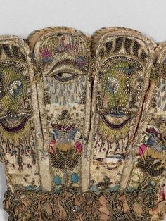 Detail of a glove * ca. 1600 English. Leather; satin worked with silk and metal thread, seed pearls; satin, couching, and darning stitches; metal bobbin lace; paper.