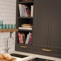 greige cabinet | gold hardware | rustic shelf | white subway tile