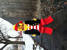 Pirate Lego man!! Made with yellow, red, black and white duct tape over cardboard. Head made from old plastic jug with the bottom cut out. Yellow shirt and gloves and red sweat pant and this guy was transformed!