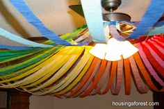DIY::Attach streamers to a hula hoop and hang. Genius!