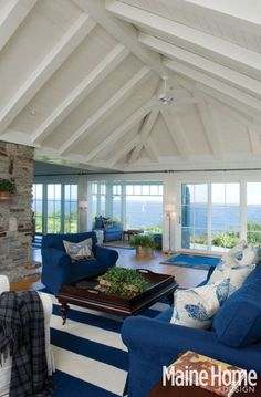 Classic blue and white. Sailor chic stripes with large area rug. Maine Home & Design. Nautical Decorating Ideas: http://www.completely-coastal.com/p/decorating-ideas-and-tips.html