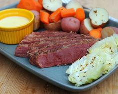 Caraway Corned Beef, a #StPatricksDay favorite, the whole meal, meat, carrots, potatoes and cabbage with a drizzle of cheese sauce. #LowCarb
