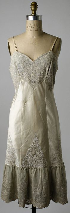 Embroidered silk slip, Chinese, early 1920s. Worn by Mrs. Herbert Sage Mesick (part of a lingerie set, with nightgown, and tap pants and bra).