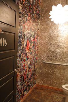 very cool bathroom boasts aluminum foil walls and a comic book feature wall!