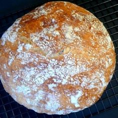 Crusty Bread - No Need to Knead! Easiest bread you'll ever make! Combine 4 ingredients. Cover. Allow to sit for 12 to 18 hours. Bake. Amazing!