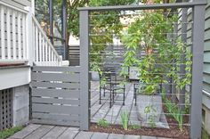 Create a living privacy fence. Cable wires mounted between fence posts create a sturdy support for climbing plants. Over time the plants can completely fill in the area, providing privacy for the patio.