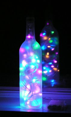 Christmas Crafts with Wine Bottles   Frosted Wine Bottle Light with multi-colored pastel LED lights inside ...