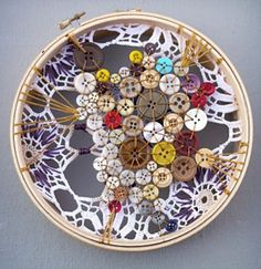 Dream catcher strewn with buttons.