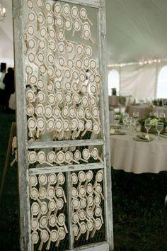 DIY vintage door wedding escort card display made from a vintage door, chicken wire and clothes pins!  vintage wedding decor.  refurbished doors.  wedding decor ideas.  DIY wedding.  rustic wedding decor.