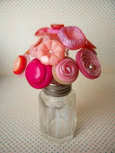 Vintage button flower bouquet in a salt shaker. Cute for Mothers Day.