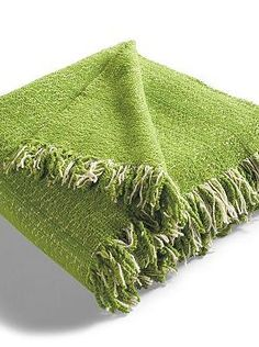 Plush and cozy, the Outdoor Throw in Sunbrella Apple is the perfect way to keep warm on chilly summer nights outside.