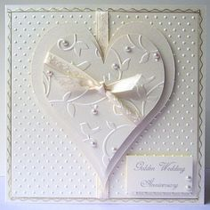 Cuttlebug embossing folders-cut into shapes and layered-no website