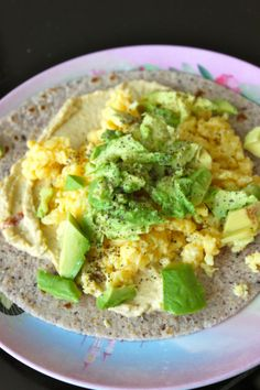 The Best Scrambled Eggs. Using coconut oil, 3 eggs, served on tortilla with hummus, avocado & pepper.