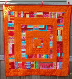 good way to use up leftover strips in a scrappy quilt - love how orange is the neutral!
