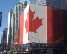 A massive Canadian flag on a building in downtown Vancouver at West Georgia and Howe Streets. Pierre Chauvot photo.