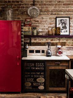Gaby Dellal, London home renovation, red refrigerator, brick wall, remodelista