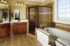The Yarborough Plan | 964  The master #bath of this lovely #Country and  #Traditional style home exemplifies the spacious feel of this open #floorplan. View the Yarborough plan at http://www.dongardner.com/plan_details.aspx?pid=2597.